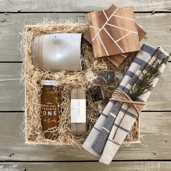custom house warming gift box with mug, soap, honey, coasters and tea towels