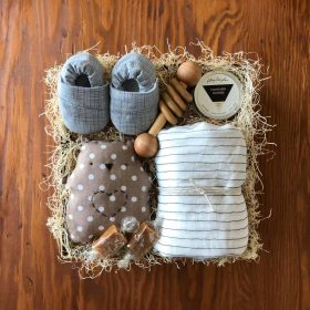 Baby Gift Box with cute toy and rattle and baby shoes by Kindred and Kel